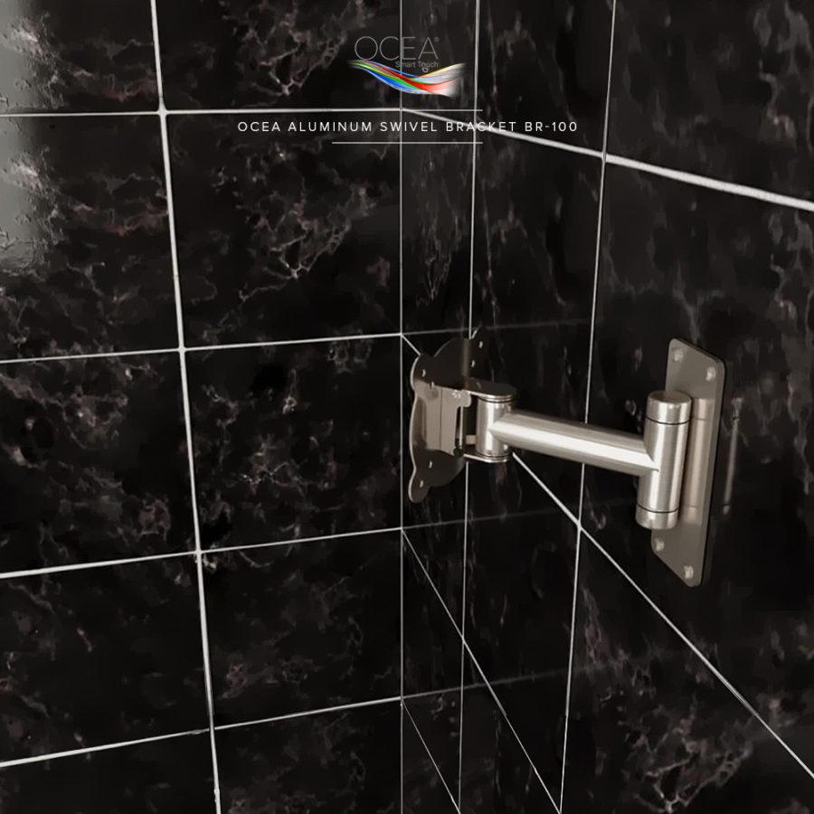 Aluminum swivel bracket for a smart touch bathroom TV.