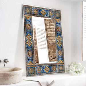 Mediterranean inspired lighted ceramic framed mirror.