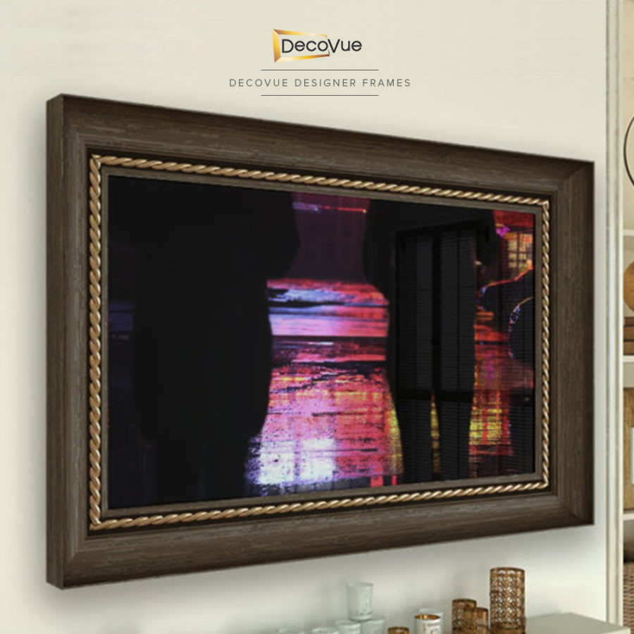 Wood frame with intricate and gold braided trim for a smart mirror TV.